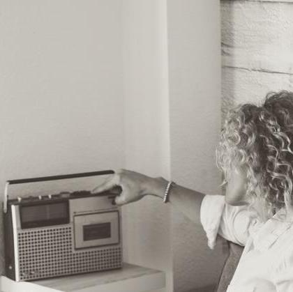 fashion-cute-curly-young-woman-home-using-old-new-technology-sitting-sofa-vintage-concept-used-radio-s-people-144166263 2 copy